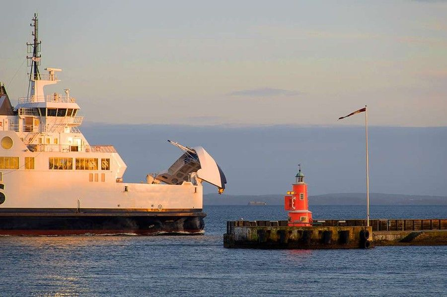 Ferry entering harbour during golden hour by Kaare Ward Jensen on 500px
