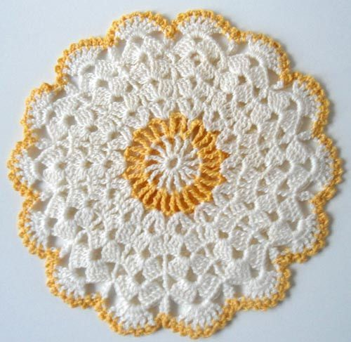 """Watch Maggie review this pretty Vintage Blue & Yellow Potholder Crochet Patterns! Design by: Maggie Weldon Skill Level: Intermediate Sizes:Shells in the Round - About 7"""" diameter Yellow & White Dress"""