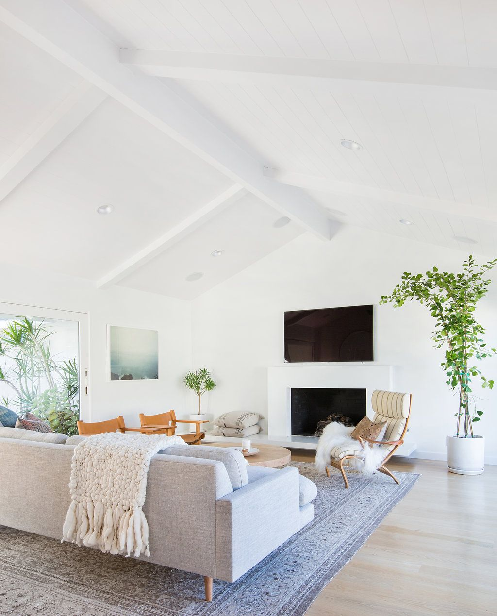 Mid-century modern living room with stone fireplace, neutral ...