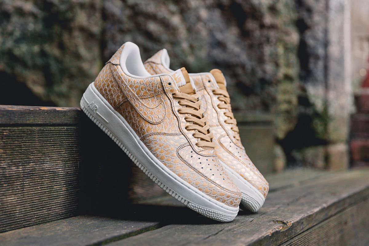 5314b56354b Nike Gives the Air Force 1 07 LV8 a Scaly Metallic Gold Look ...