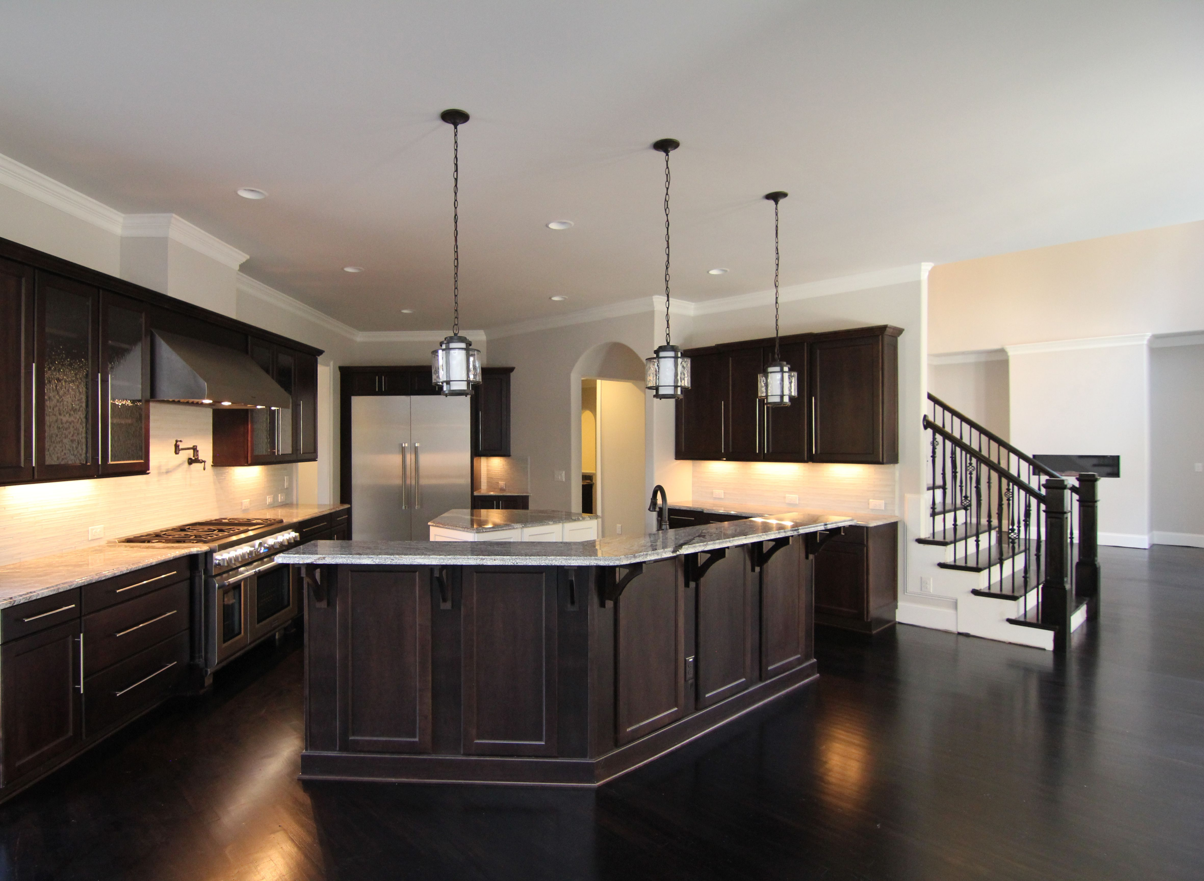 Wrap Around Kitchen Island With Eating Bar In Contemporary Style