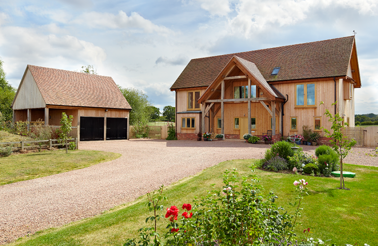 Contemporary oak frame house with giant barn style porch for Contemporary self build homes