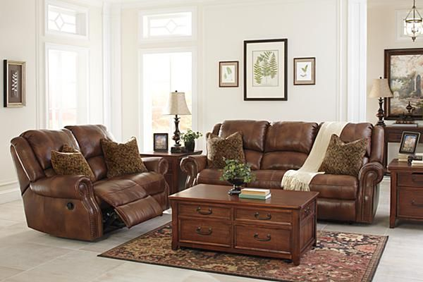 The Walworth Reclining Sofa From Ashley Furniture HomeStore (AFHS.com).  Leather Match Upholstery Features Top Grain Leather In The Seating Areas  With ...