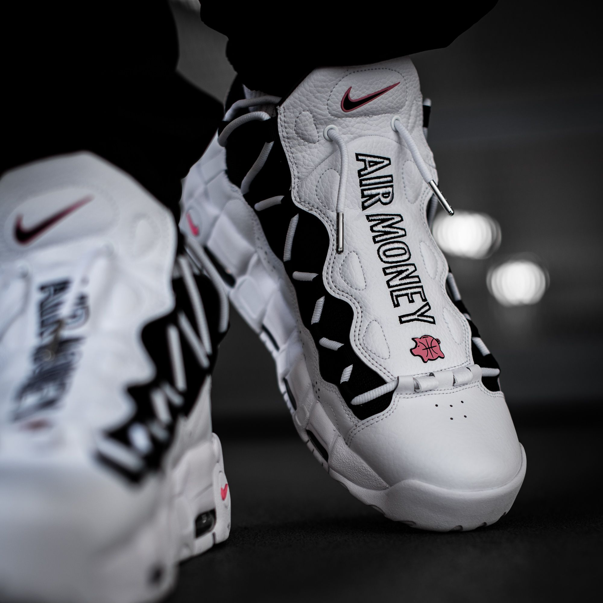 a0e7fd40e48a9a The Nike Air More Money silhouette is back in a premium white leather and a  coral piggy bank logo