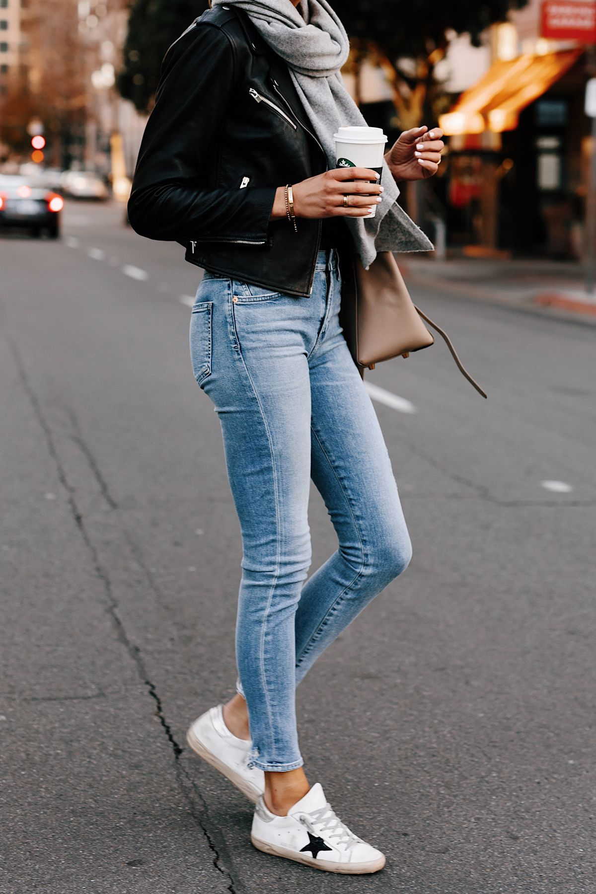Woman Wearing Black Leather Jacket Grey Scarf Denim Skinny Jeans Golden Goose Sneakers Fashion Jackson San Diego Fashion Blogger Street Style #leatherjacketoutfit