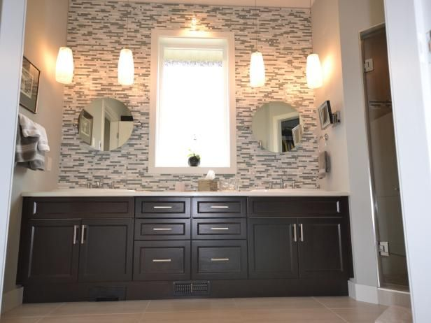 A Mosaic Tile Backsplash Covers The Wall Behind An Espresso Vanity In This Modern Bathroom