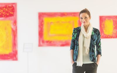 Woman curator with paintings in museum   Teaching skills ...