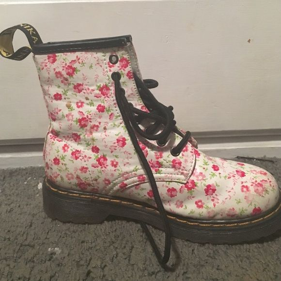 Jennika floral combat boots Only worn once. Bought in London.In great condition Jennika  Shoes Combat & Moto Boots