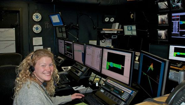 Marah Dahn gets hands-on seafloor mapping experience in the control room of NOAA Ship Okeanos Explorer.