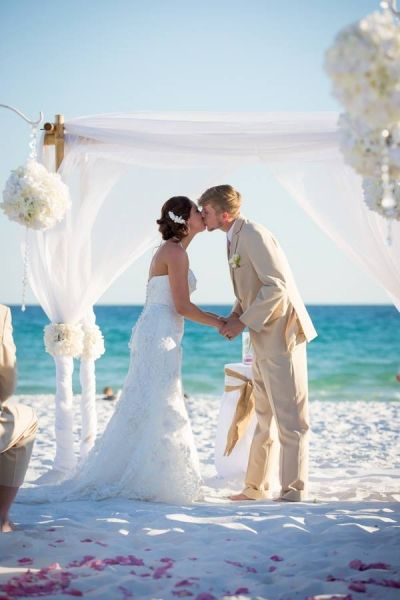 Beach Wedding Ceremony Bride And Groom First Kiss Photography White