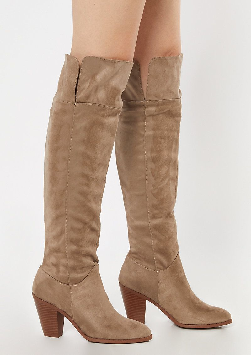 Stacked heeled over-the-knee boots made of cool faux suede with a zipper side closure.
