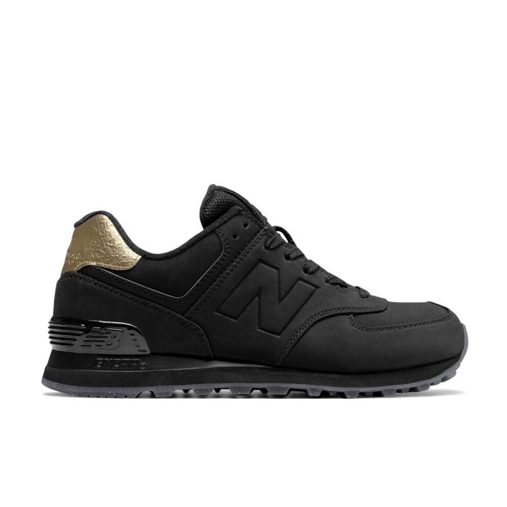 Designer: New Balance Color: Black / Gold Winter style is made for cool hues and on-trend metallic highlights. Your wardrobe is ready to take on lower temps with the women's 574 that features metallic