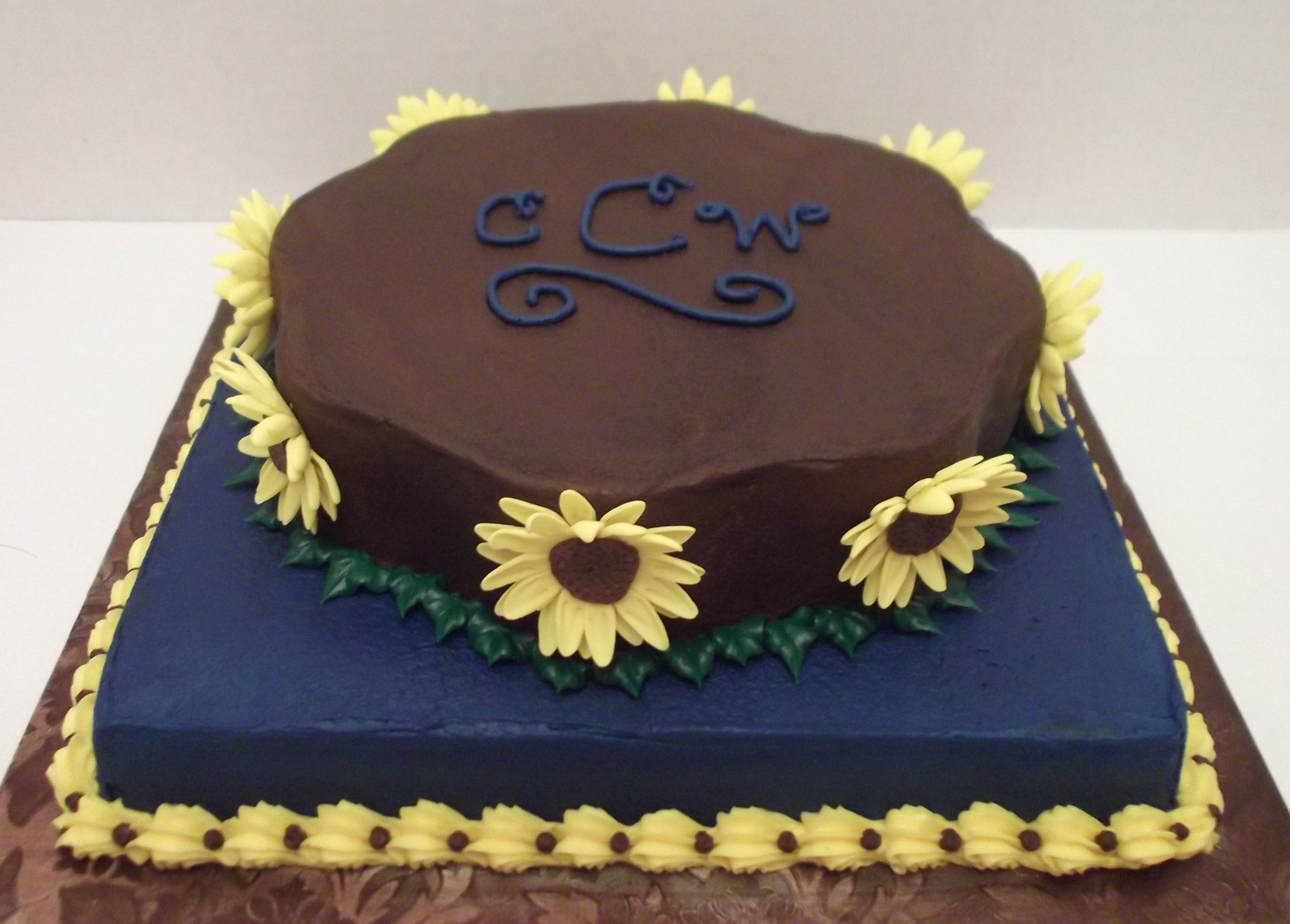 Denim & Sunflowers - 9 inch petal / 10 inch square - white cakes covered and filled with buttercream. Sunflowers are gumpaste. The wedding theme/colors - denim, brown, & sunflowers.