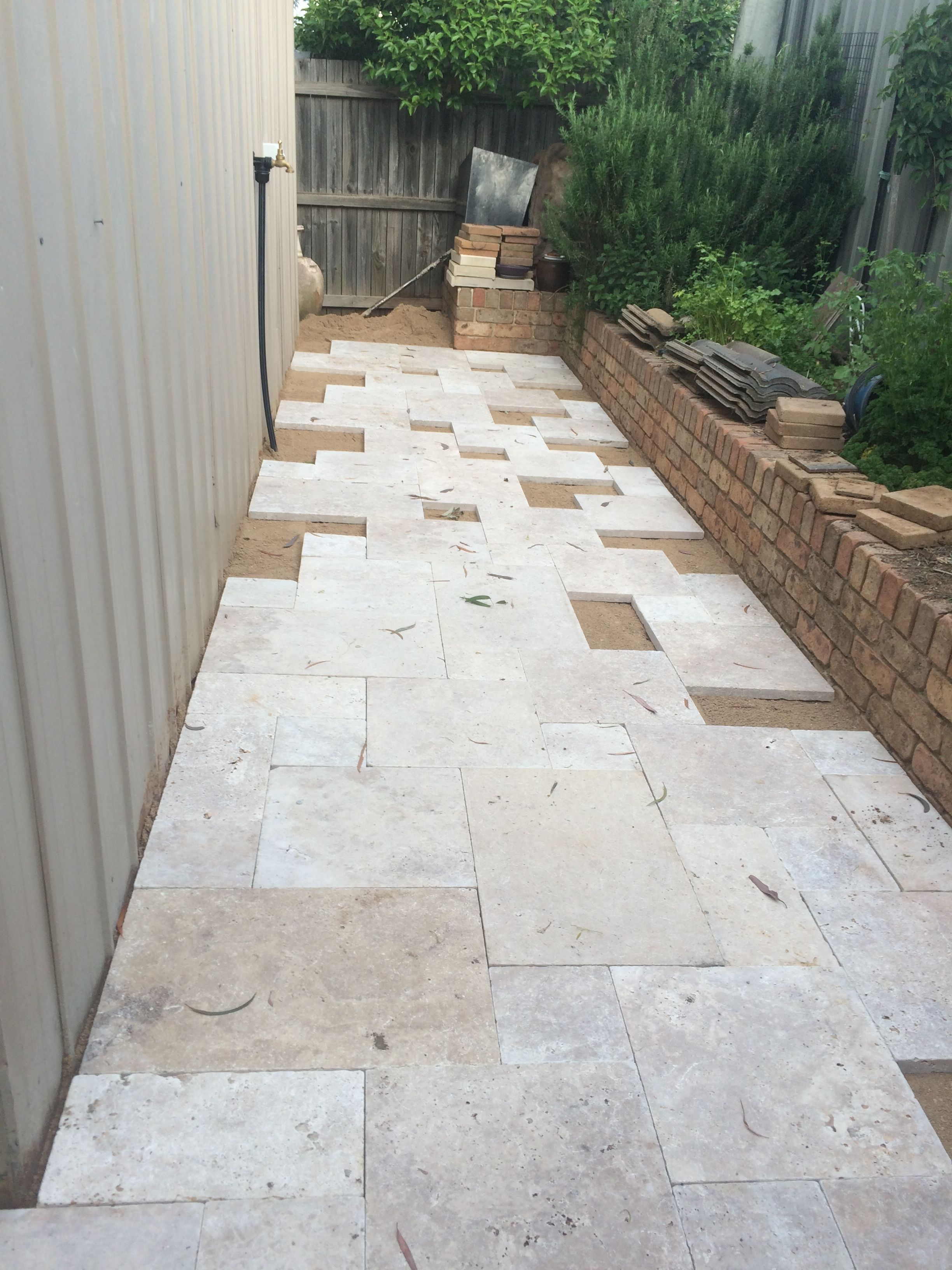 Laying French Pattern Travertine Landscape Contractor