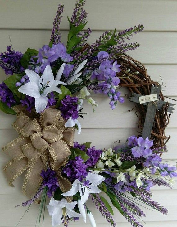 Photo of Easter wreath with wooden cross and wine wreath