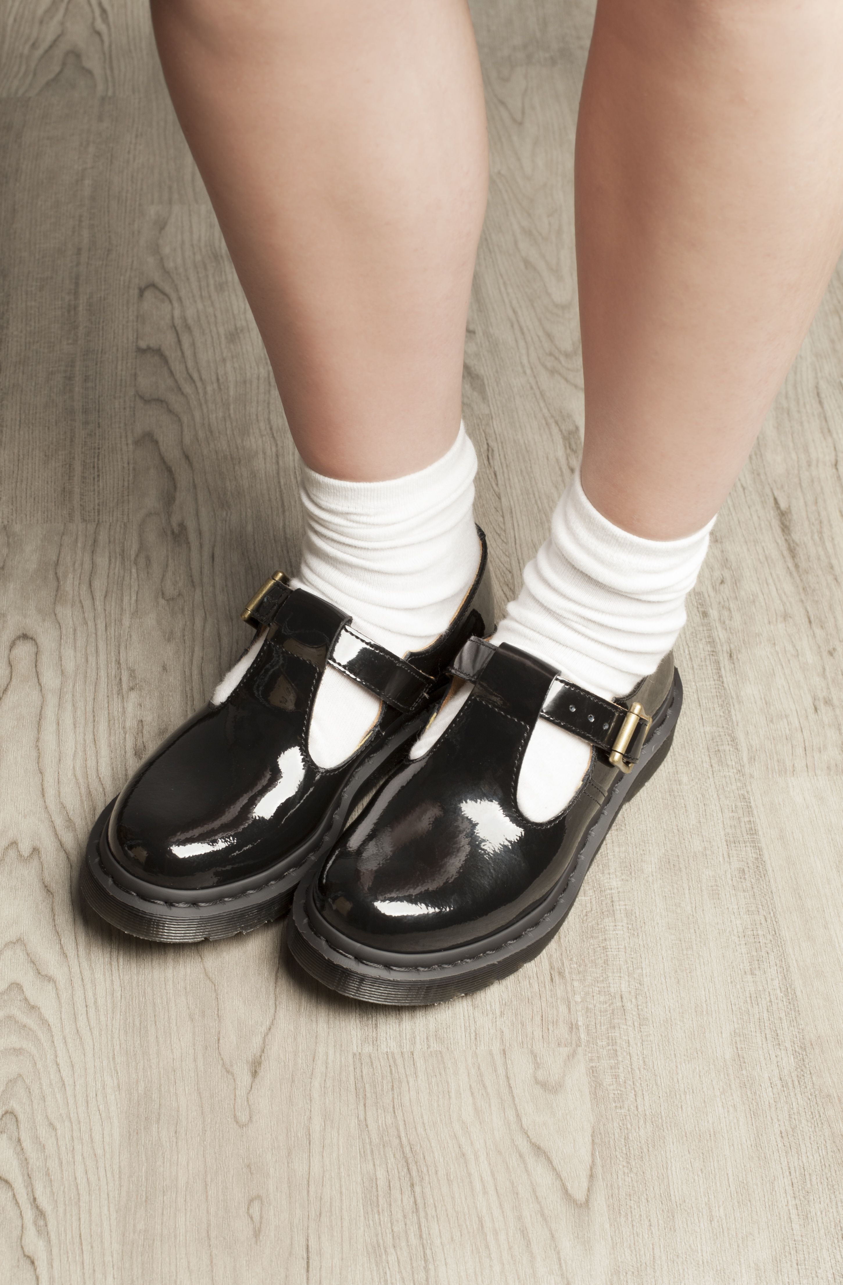 5726efbf3df Smarten up your act in the Dr Martens black patent Polley t-bar flats.  Crisp white ankle socks recommended.