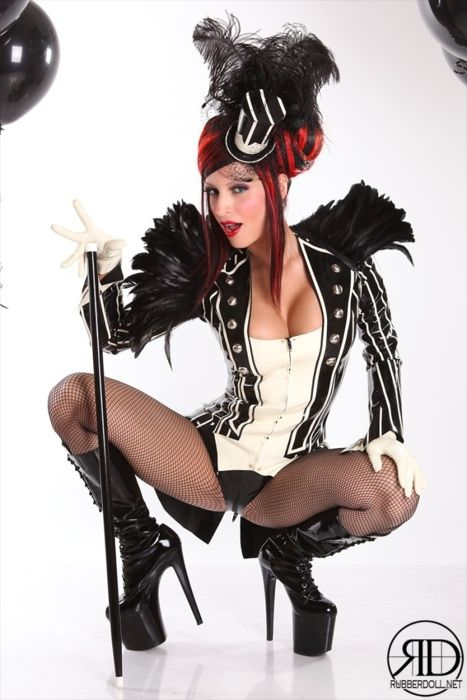 Burlesque costume top hat feathers stripes boots goth circus red hair girl performer aristrocrat
