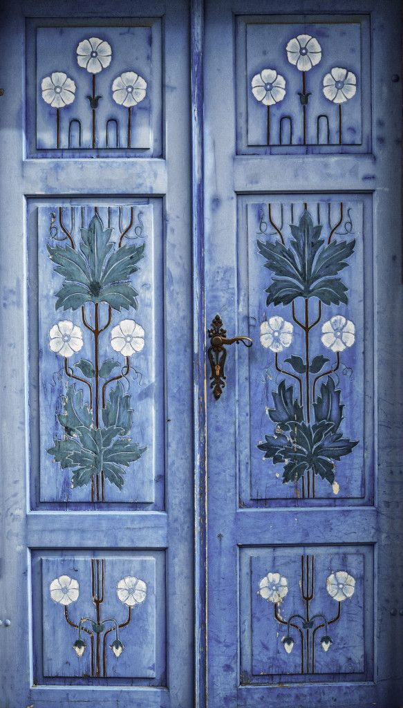 Blue Door in Kutna Hora Czech Republic Photo Andrew Proudlove & Periwinkle antique door painted with designs on the panels ...