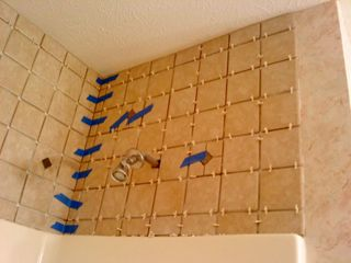 Laying tile above shower surround. | Bathroom cabinet redo ...