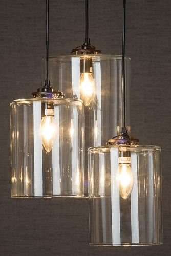Three glass cylinder pendant light two medium shades and one large three glass cylinder pendant light two medium shades and one large shade hung from metal ceiling fitment cables 1m long but can be cut to suit e14 bulbs aloadofball Gallery
