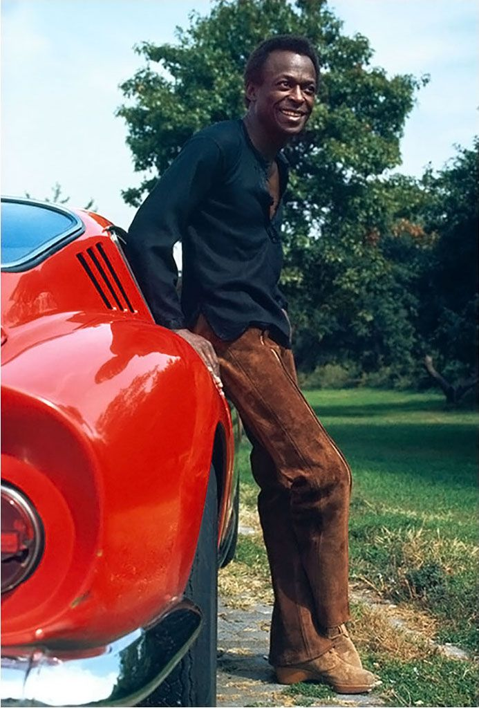 Miles Davis and his Ferrari 275 GTB at his home in New York City, October 1969   Ph: Baron Wolman
