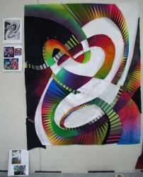 Quilt in progress on wall of studio