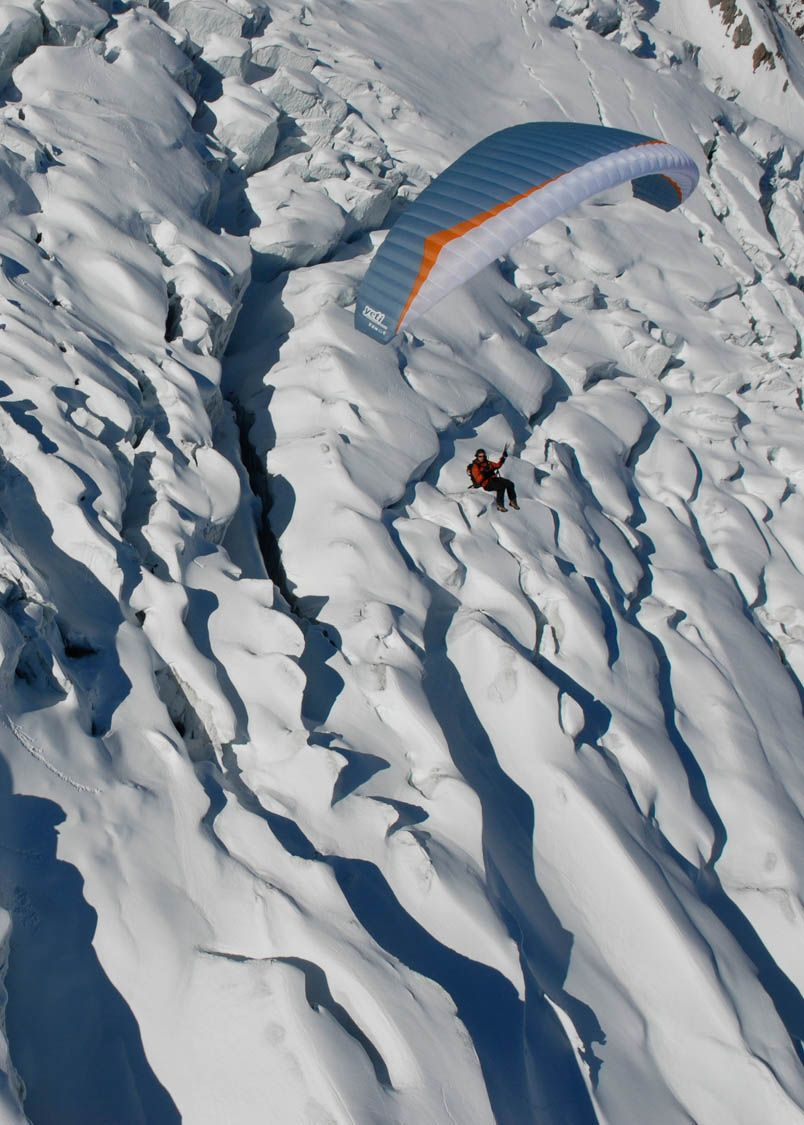 Paragliding over snowy Verbier.  Tandems and courses with English and French speaking instructors.