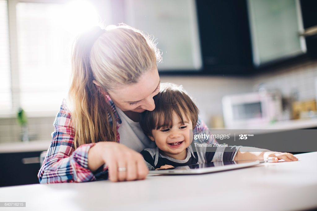 Mother With Her Son Using A Digital Tablet Babysitter Jobs Babysitting Jobs Screen Time