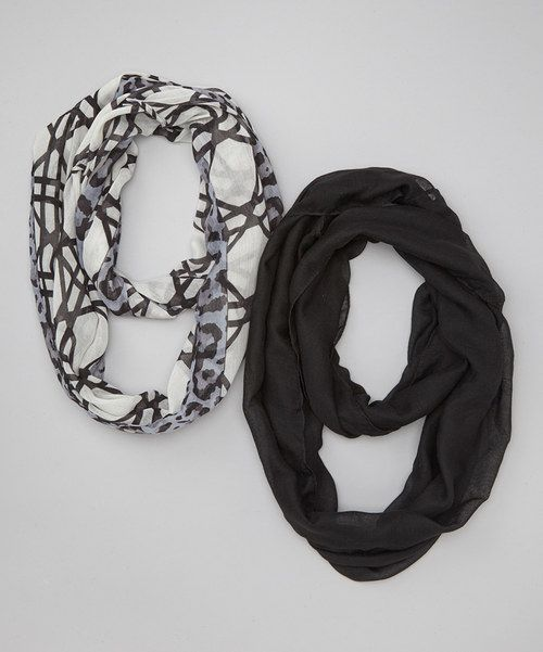 Get the layered look this fall with a single circle of knit goodness. The infinity scarf can be looped once, twice, or multiple times for a cozy and trendy look.Includes two infinity scarves20'' x 35''100% polyesterHand wash; hang dryImported