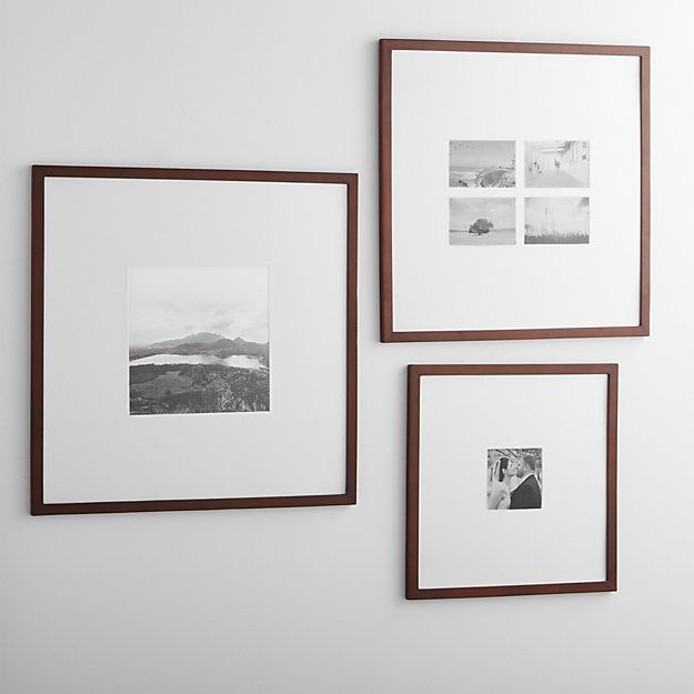 Classic brown wood and extra-wide white mat frames in a modern ...