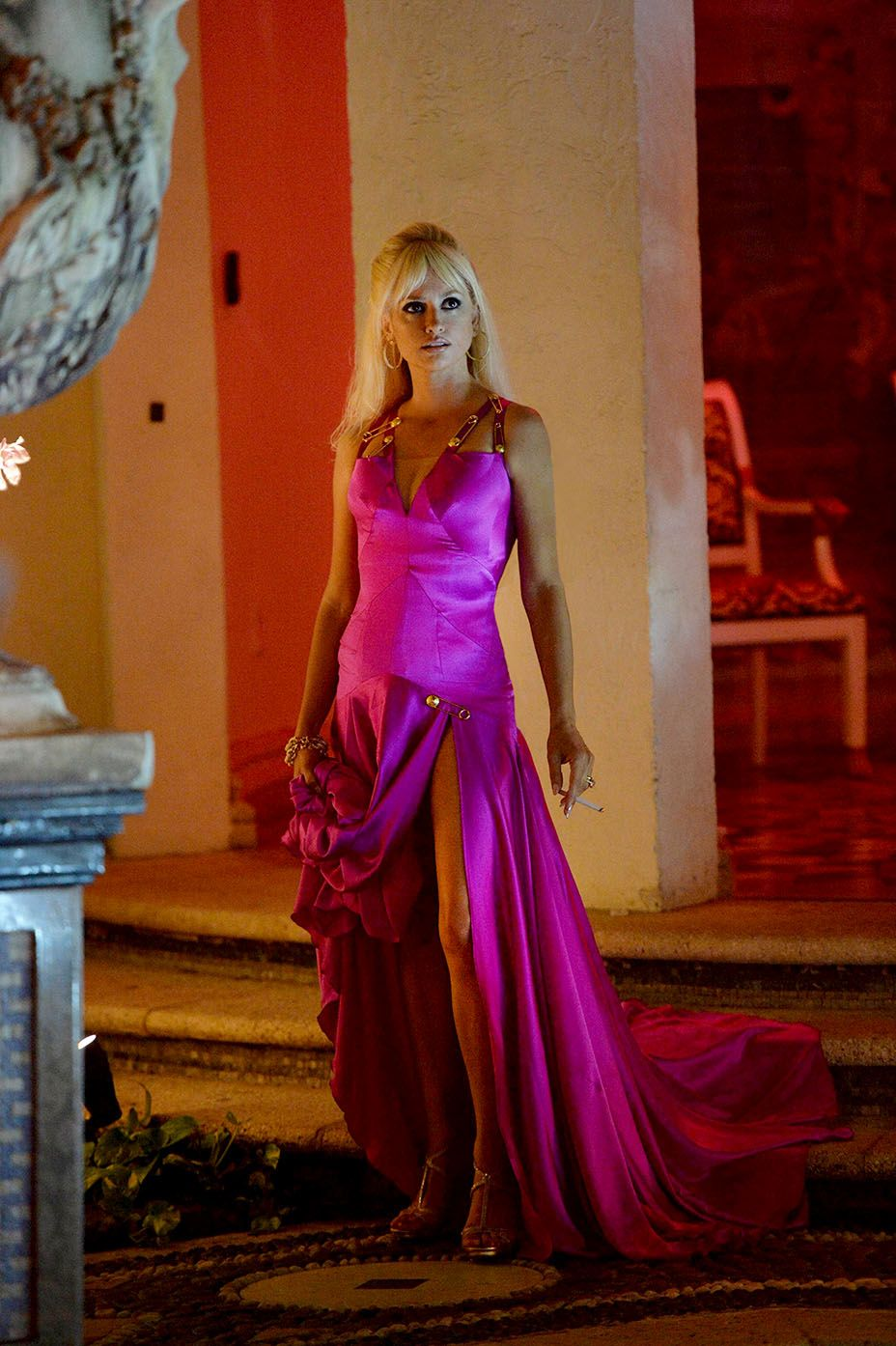 Penelope Cruz as Donatella Versace wears a pink gown inspired by a 1996  Versace design. d5227deb9
