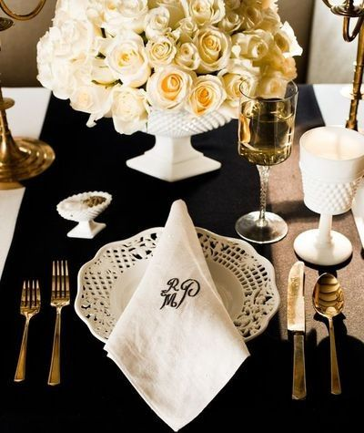 "Instead of a lace topper pair a bold runner with milk glass and ""lace-like"" place setting"