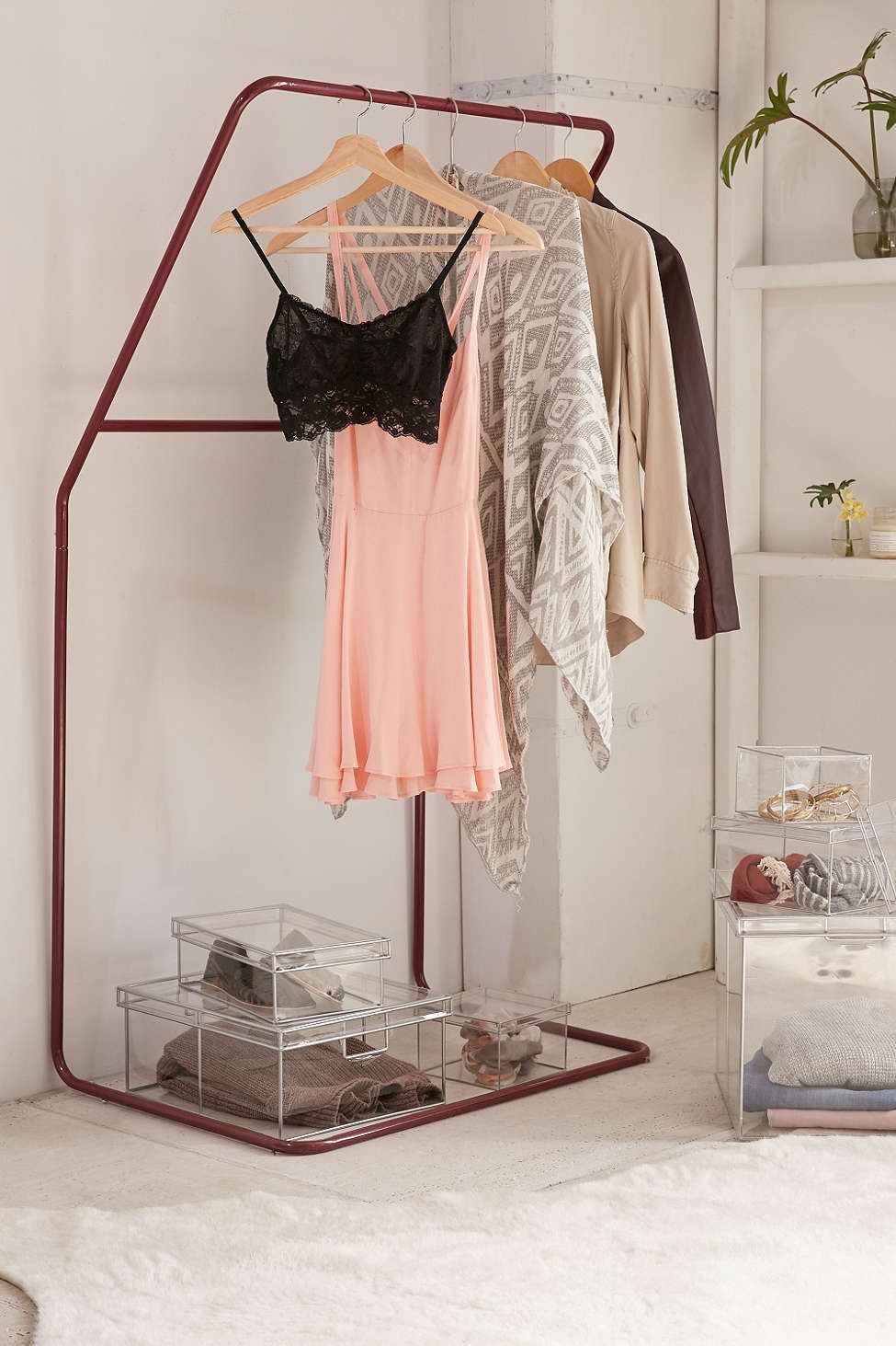 Leaning clothing rack spaces apartments and dorm