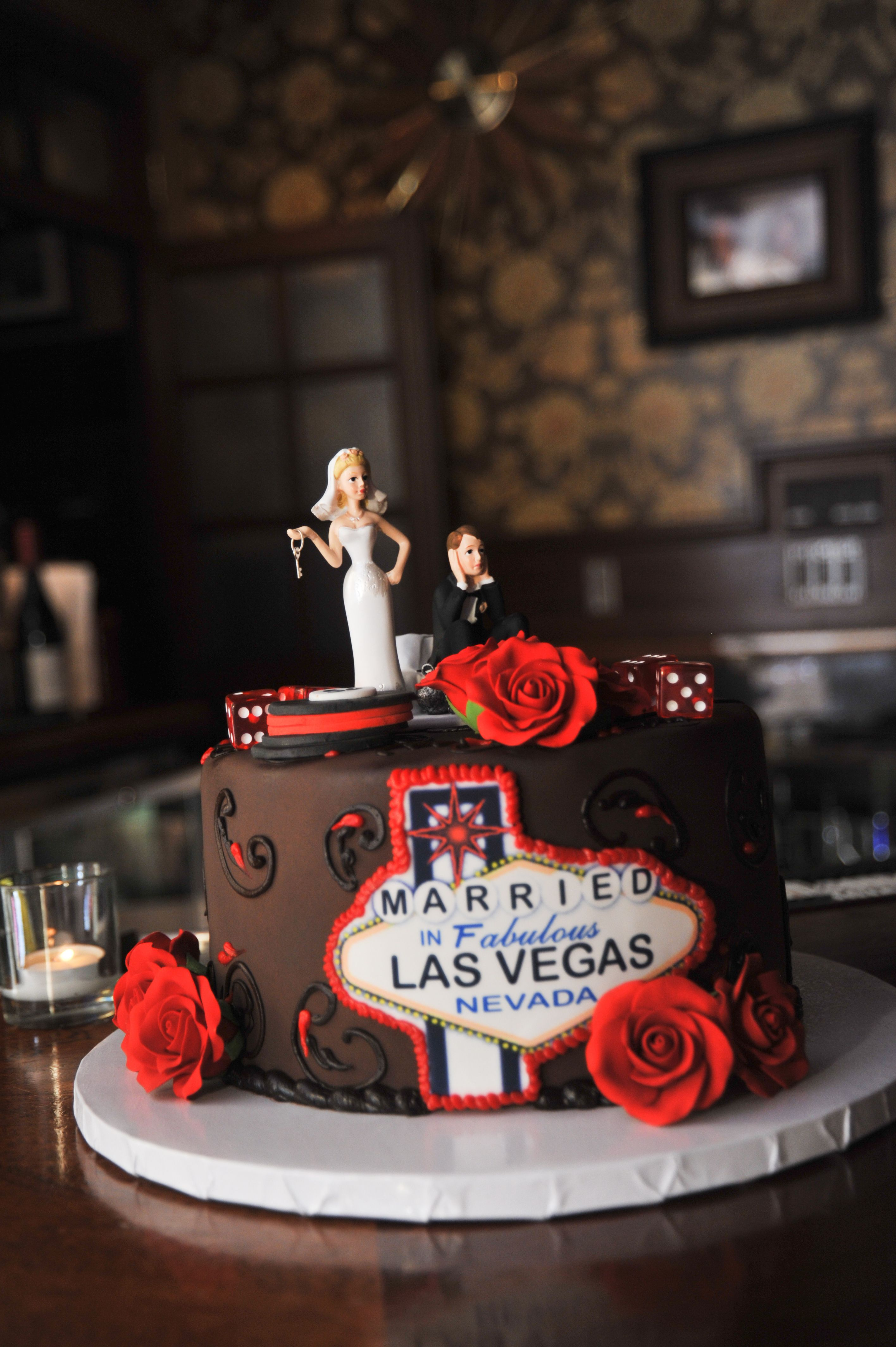 Customized cake toppers are a great way to personalize your Las Vegas  themed wedding cake.