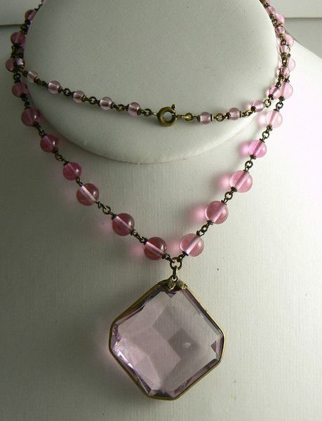 """Czech Graduated Bead Necklace Pink Faceted Glass Pendant. Lovely shade of pink glass set in a brass chain. Measures 24"""" in length and the pedant measures 1 1/4"""""""