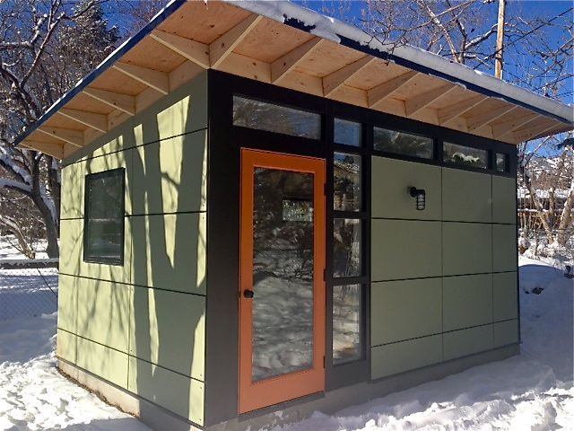 Green earth siding yam orange door our bronze metal for Modular studio shed