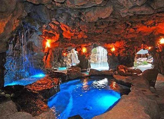 Cave room with swimming pool and waterfalls drake snags la cave home for a discounted price of for Natural swimming pools los angeles