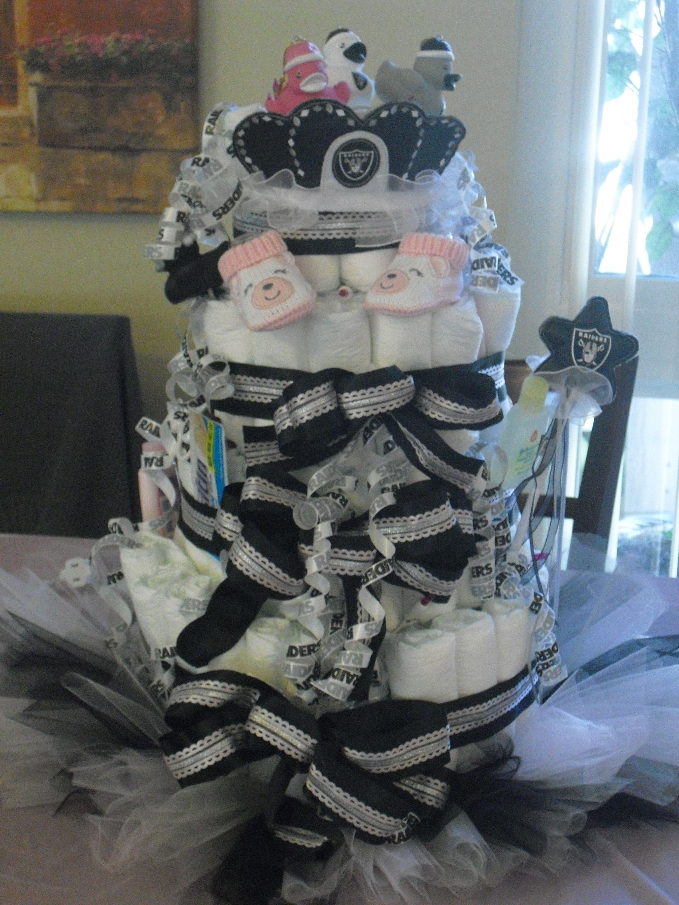 Raiders Diaper Cake Sitting On A Tutu
