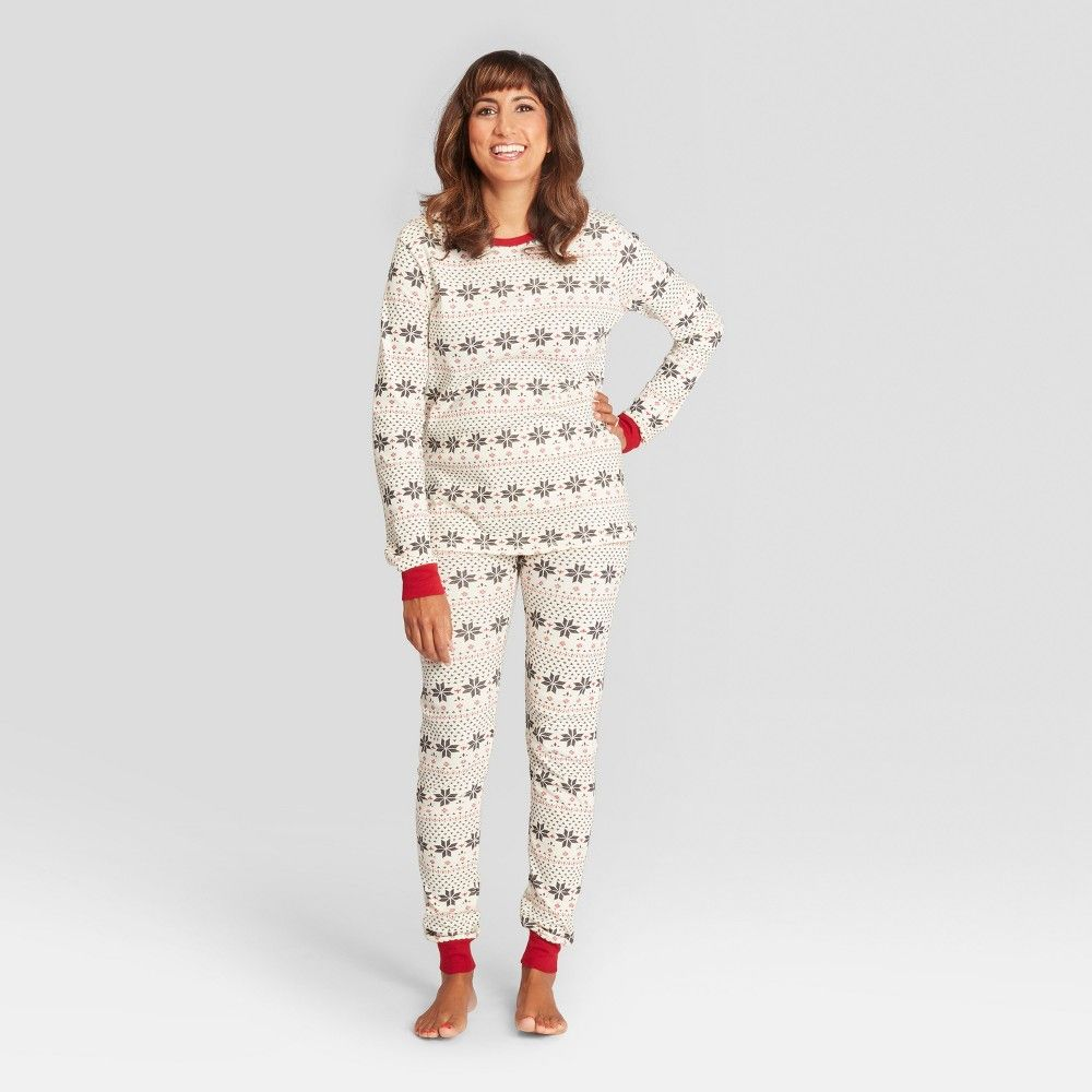 ca1eca757a6a The Holiday Snowflake Pajama Set from Burt s Bees Baby is made from ...
