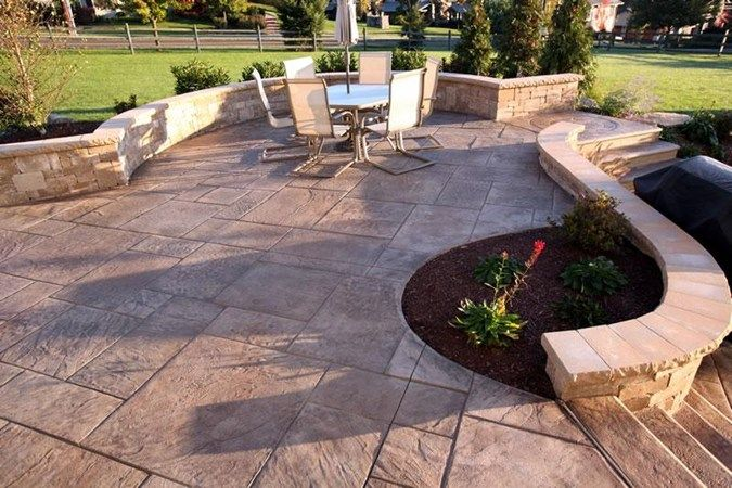 Stamped Concrete Patio With Seating Wall Also Has A Fire Pit Below Poured Concrete Patio Concrete Patio Cost Concrete Patio