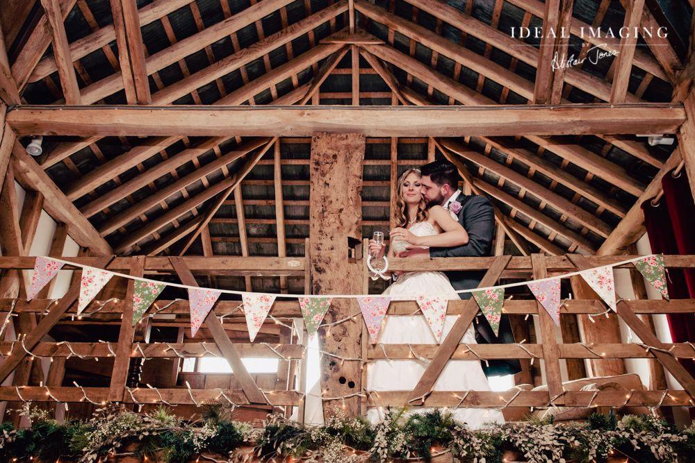 Pitt Hall Barn Wedding Photographer: Tara & Steve Alistair Jones - Ideal Imaging Balcony shot, bunting