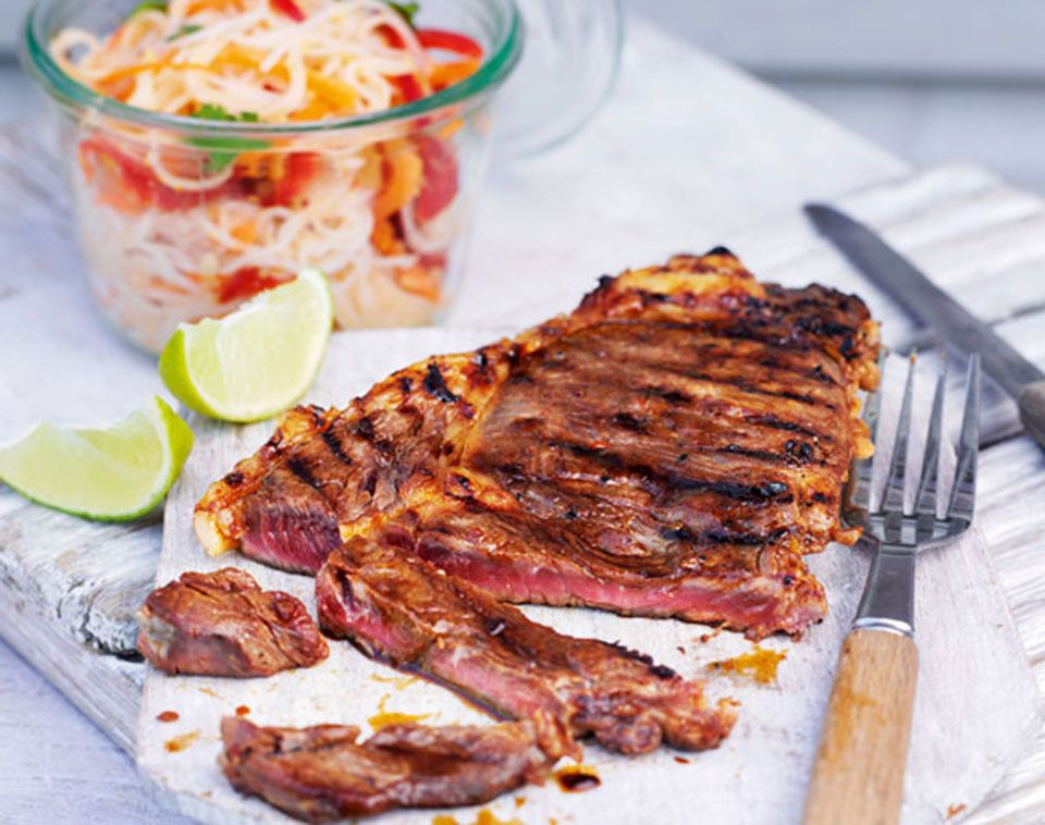These juicy steaks are marinated in sweet chilli and soy sauce and served with nutty noodle salad and fresh veg.