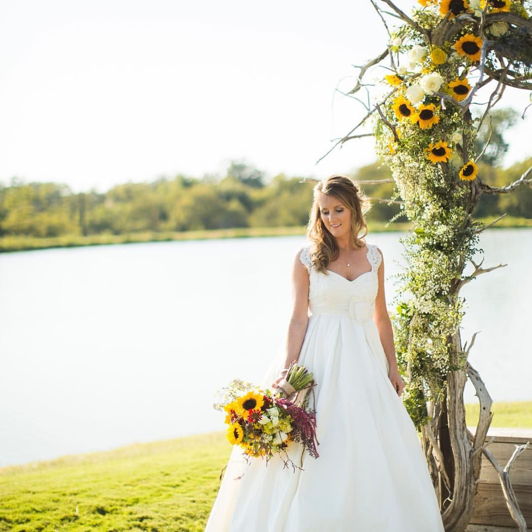 Early Fall Sunflower Wedding Arbor For Ranch Ceremony At
