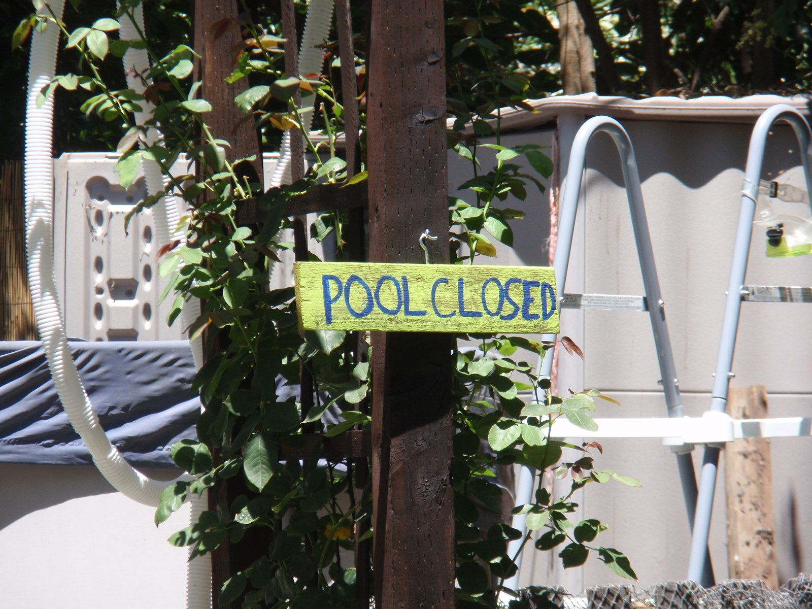 Pool Closed sign made on recycled scrap wood.. turn over for Pool open.... it's a great visual for my son with Autism to know- when swimming is available...
