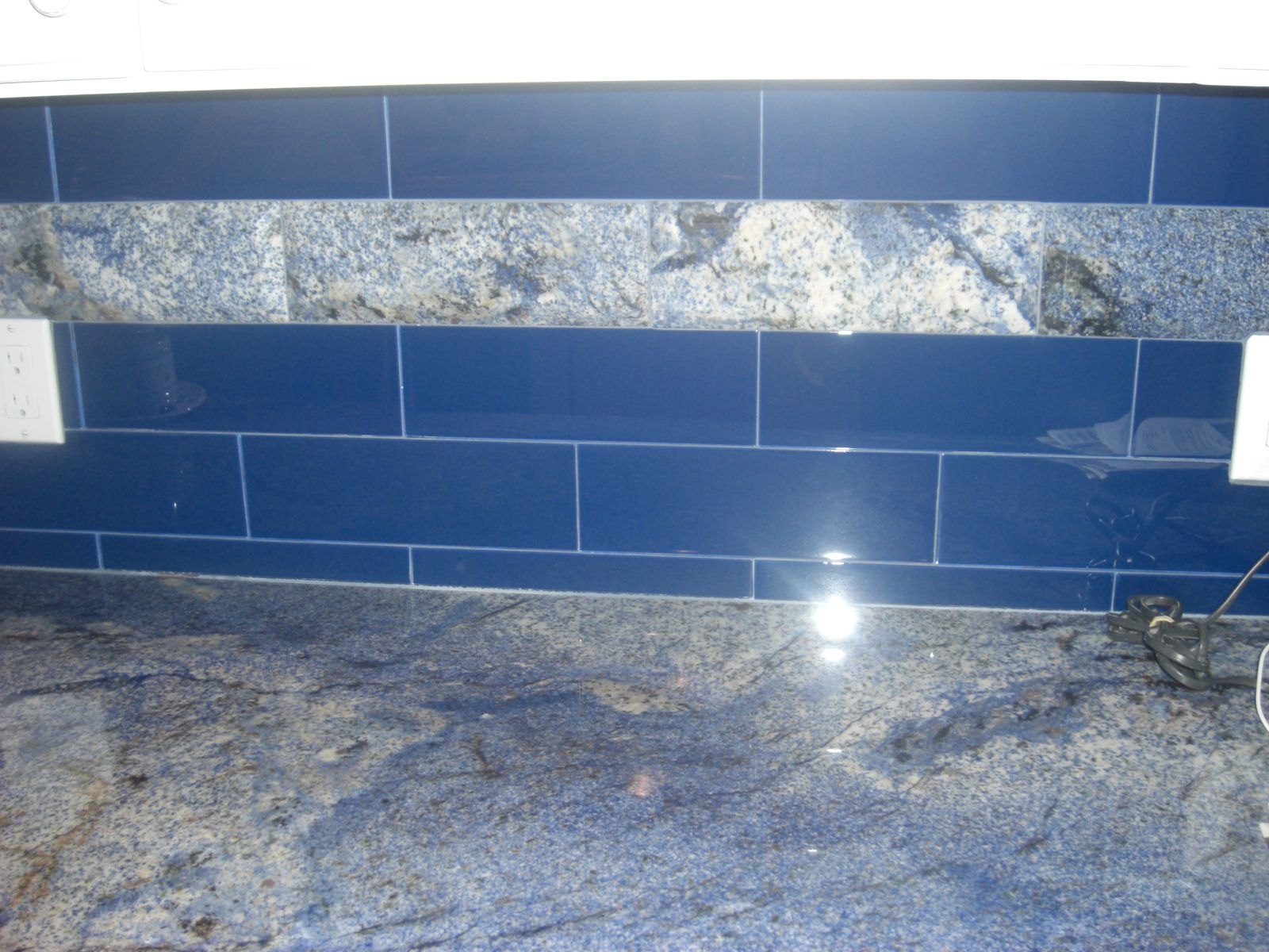 Azual Blue Granite counter tops with cobalt blue glass backsplash ...