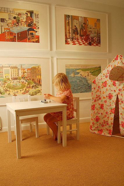 giant classic charming artwork...playroom. Might do this with multiple, slightly smaller art (pages from used books?) instead