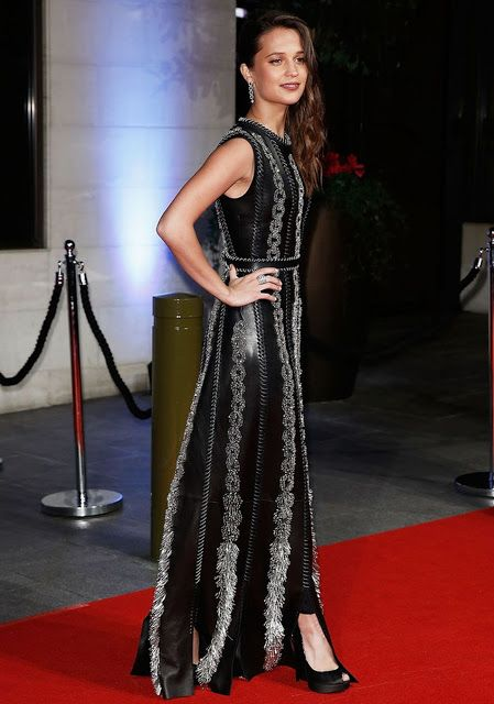 Celebrities In Leather: Alicia Vikander wears a long black leather dress