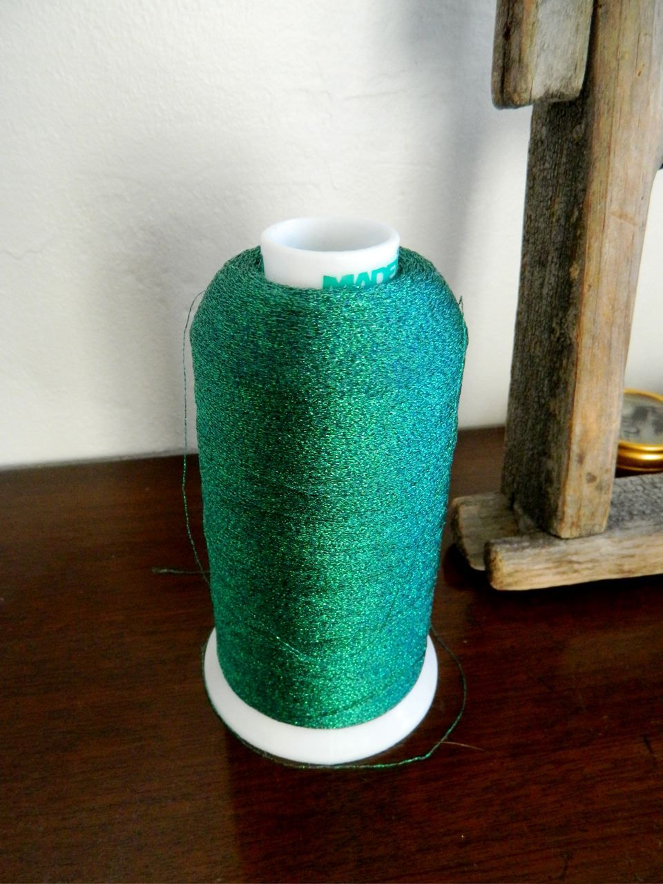 sparkly green thread for scrapbooking