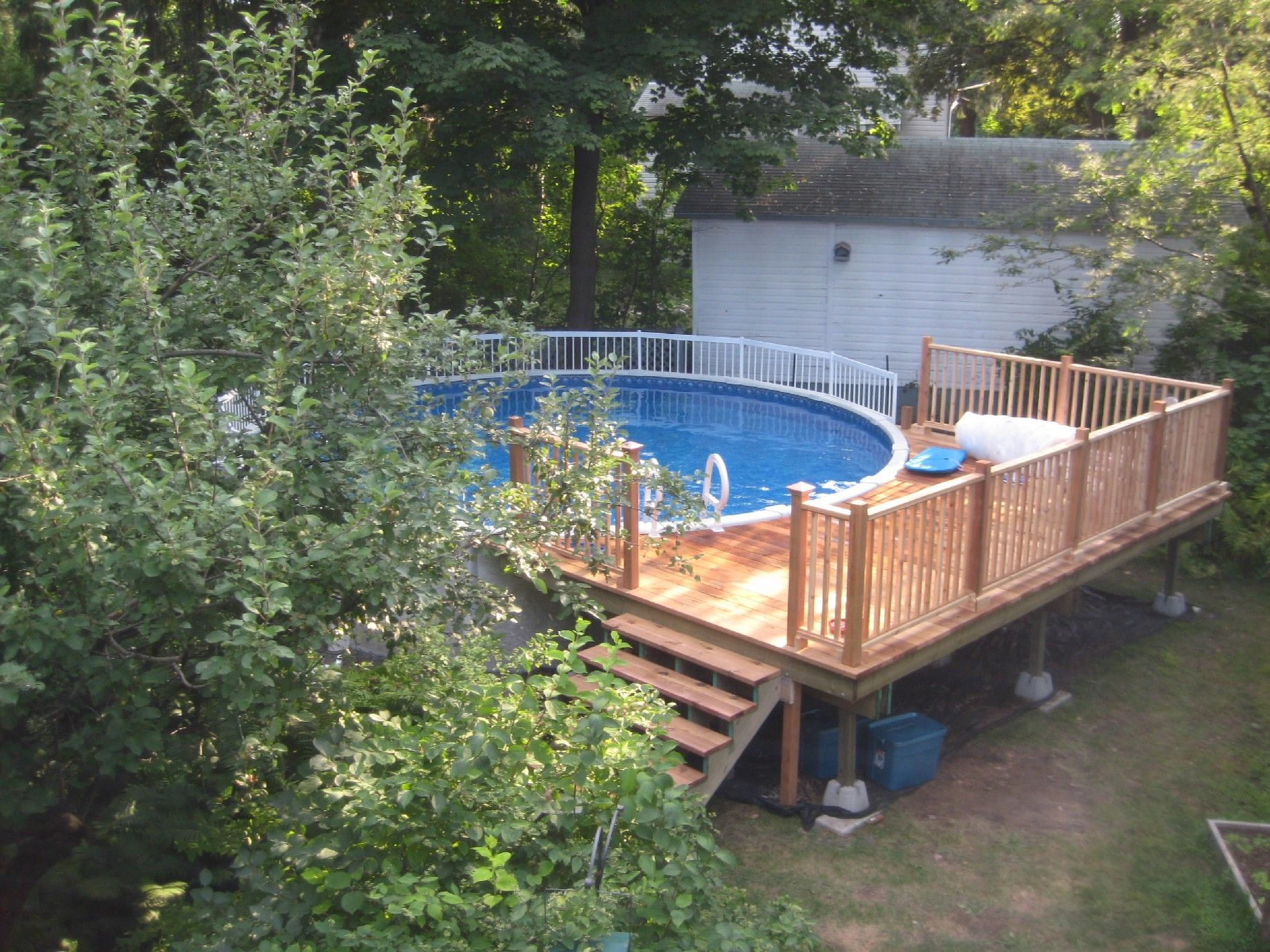Deck Design Ideas For Above Ground Pools this above ground pool is built uneven ground and uses that to extend a deck Above Ground Pool Decks Idea For Your Backyard Decor Round Above Ground Pool Decks Fro