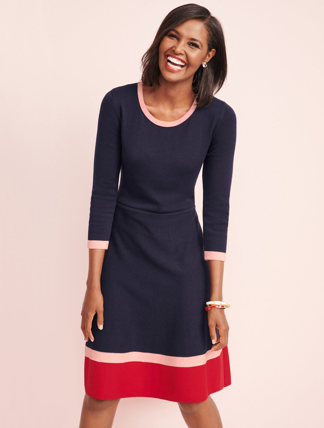34dc0b93081 This flattering sweater dress features contrast stripe detailing at its  jewel neckline and three-quarter sleeves, plus a bold stripe border.